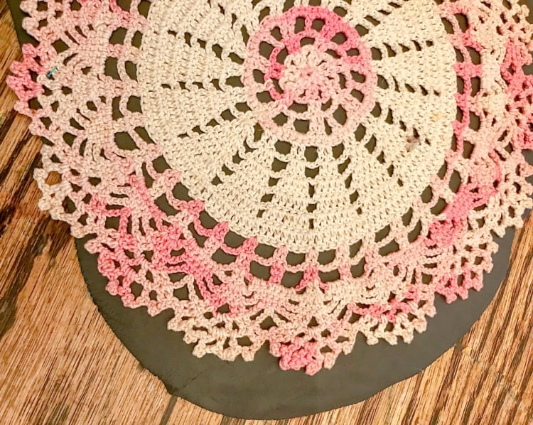 vintage crocheted doily pressing into black air dry clay.