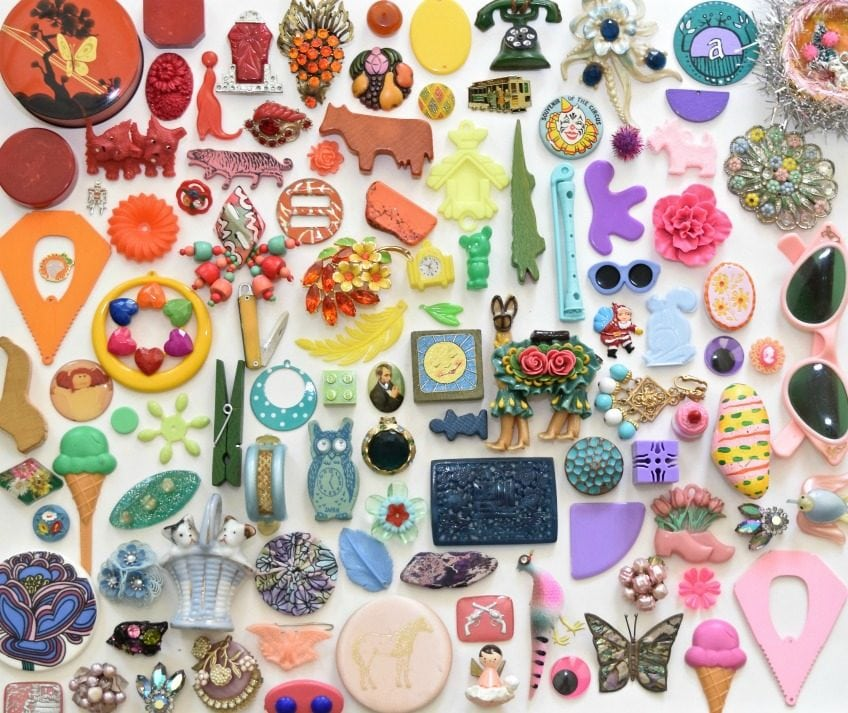 Find and seek flat lay of rainbow colored vintage toys.