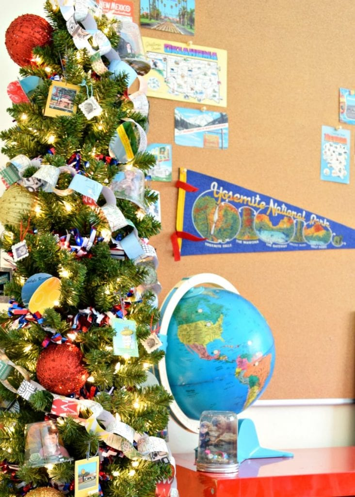 Christmas tree with paper chain decorations and globe.