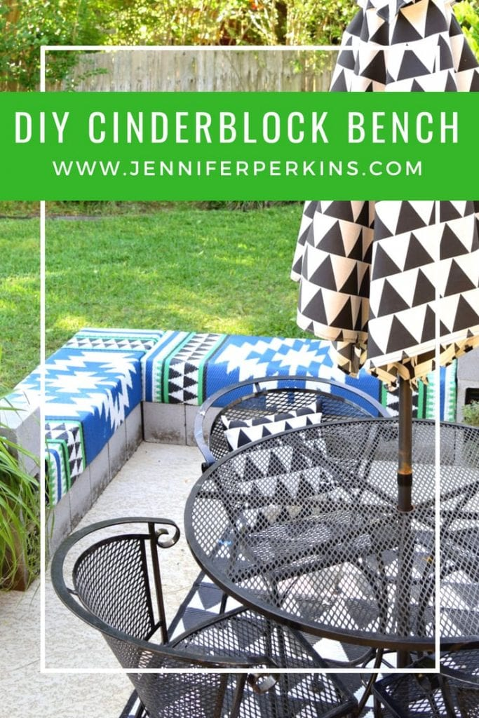 Outdoor DIY patio bench made from cinderblock bricks.