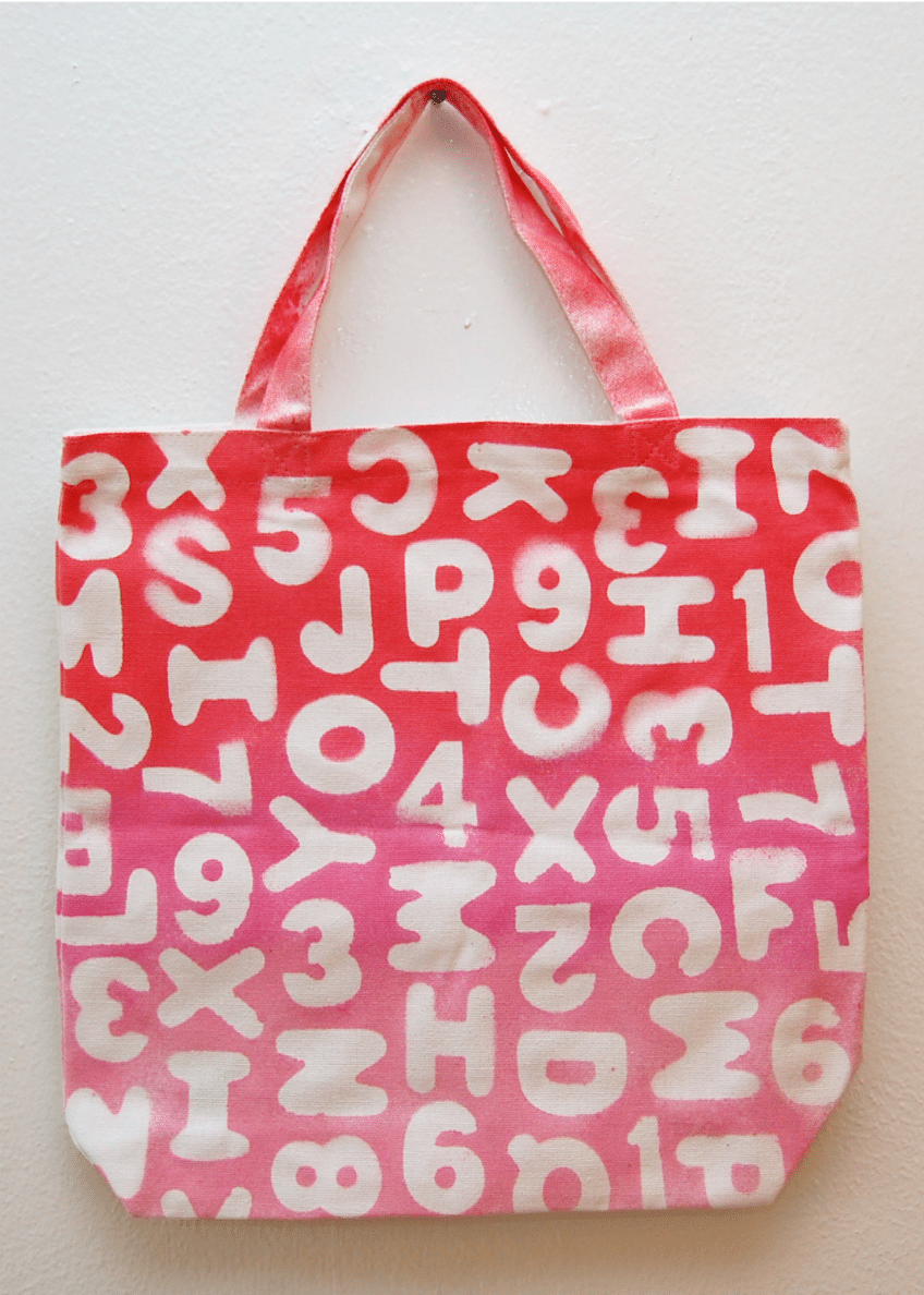 Tote bag with sticker resist ombre paint.