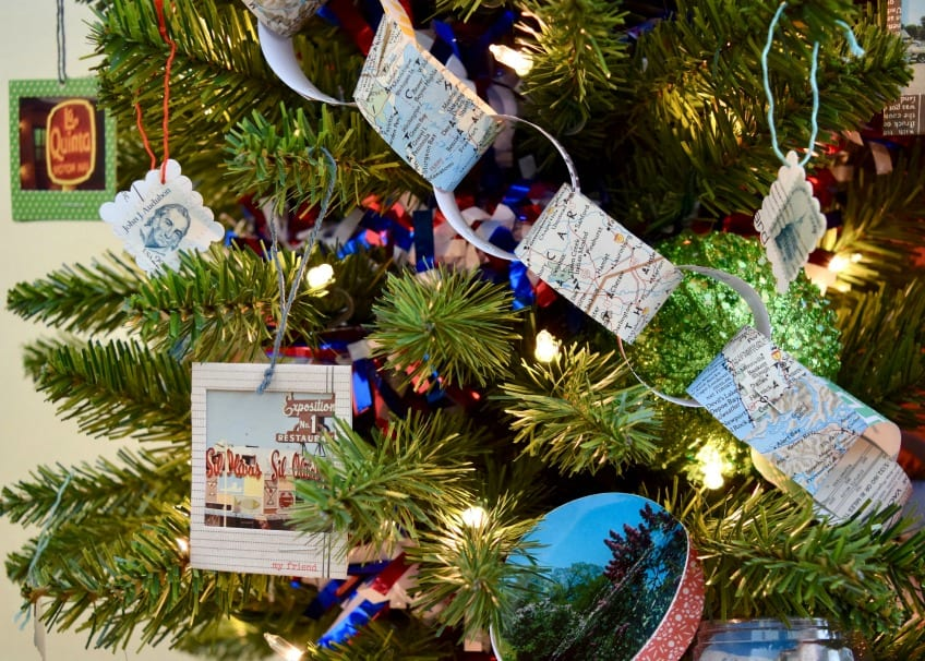 paper chain made from old maps on a Christmas tree.
