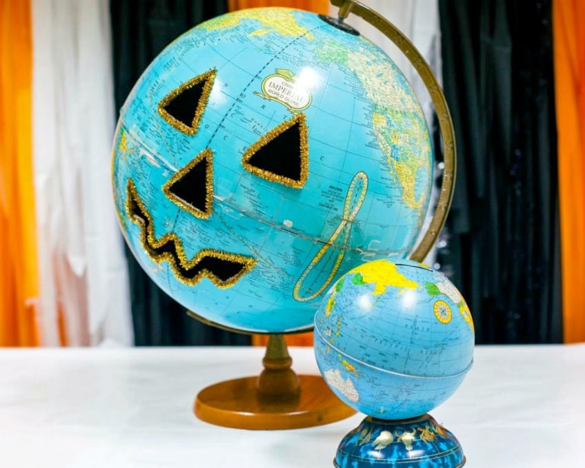 Vintage globe carved to look like a Halloween Jack-o-Lantern.