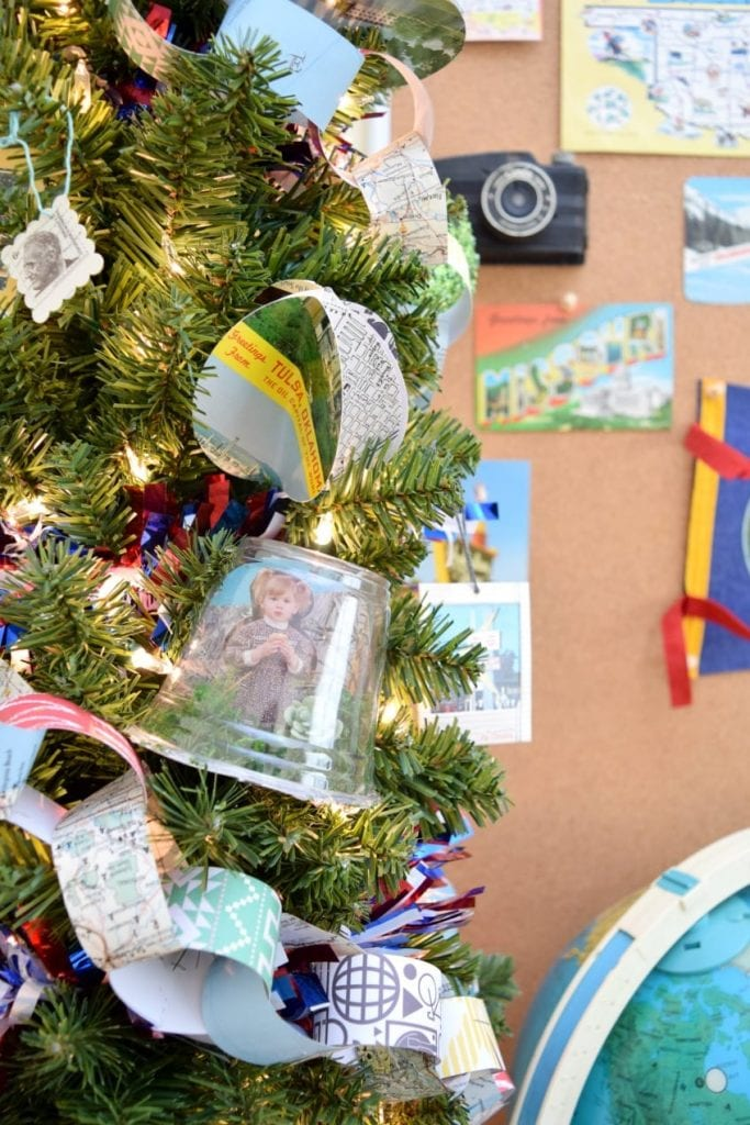 Tree with DIY snow globe ornaments made from vintage postcards.