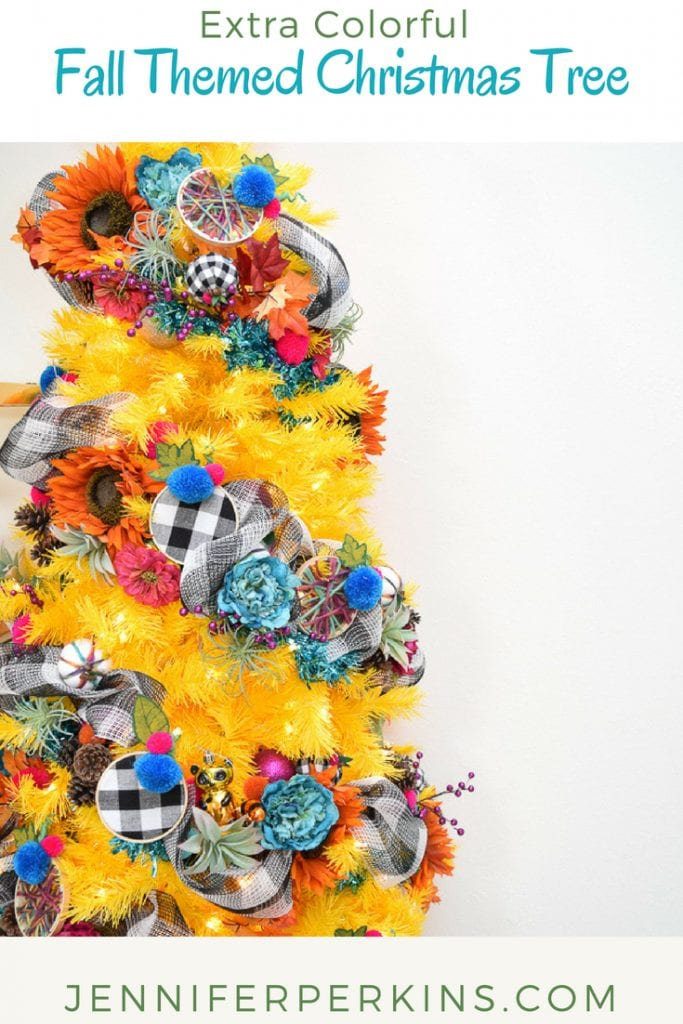 Colorful decorations with checkered pumpkins and flowers on a yellow christmas tree