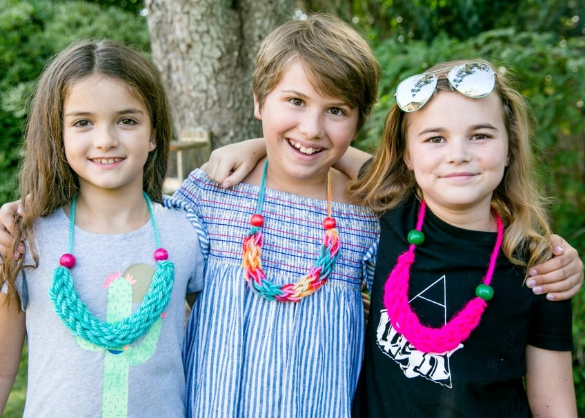 Tweens wearing finger knit necklaces