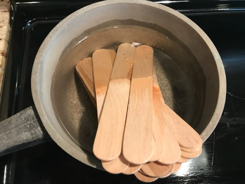Popsicle sticks boiling in water