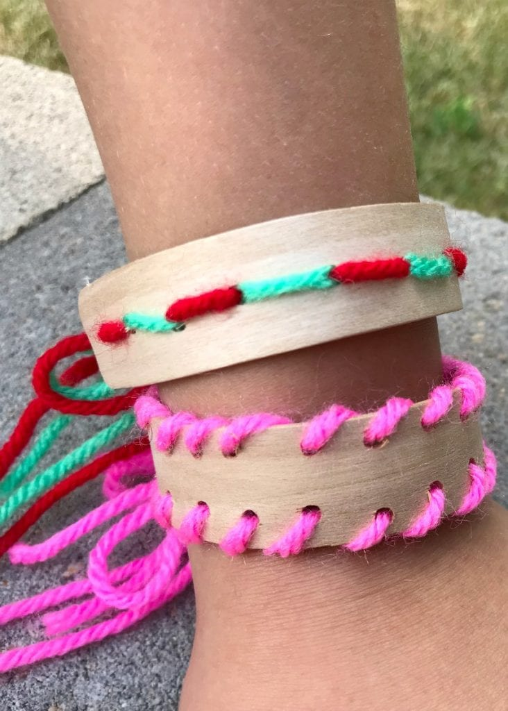 Kids bracelet craft stitched with yarn