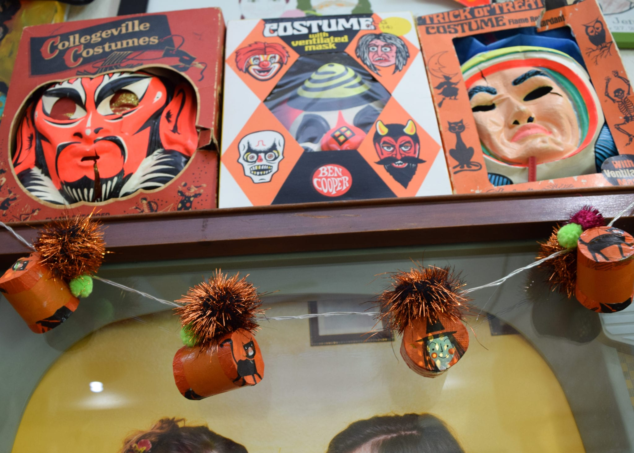 Orange Halloween string lights with vintage masks