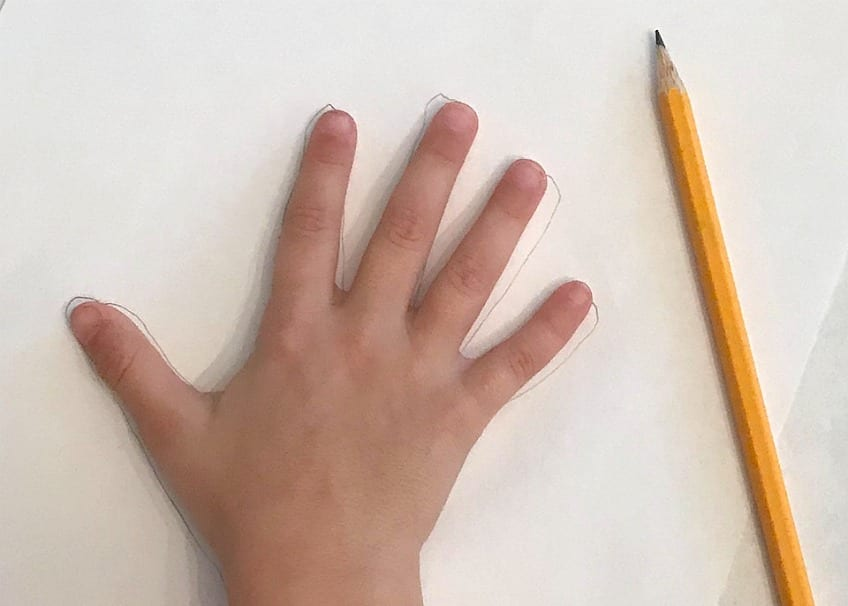 Kid's hand being traced with pencil