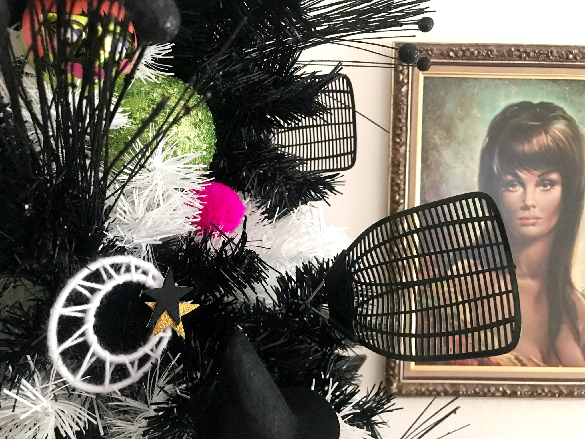 Halloween tree with fly swatters and DIY moon ornaments
