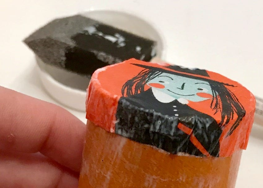 toilet paper rolls with halloween witches decoupaged on them.