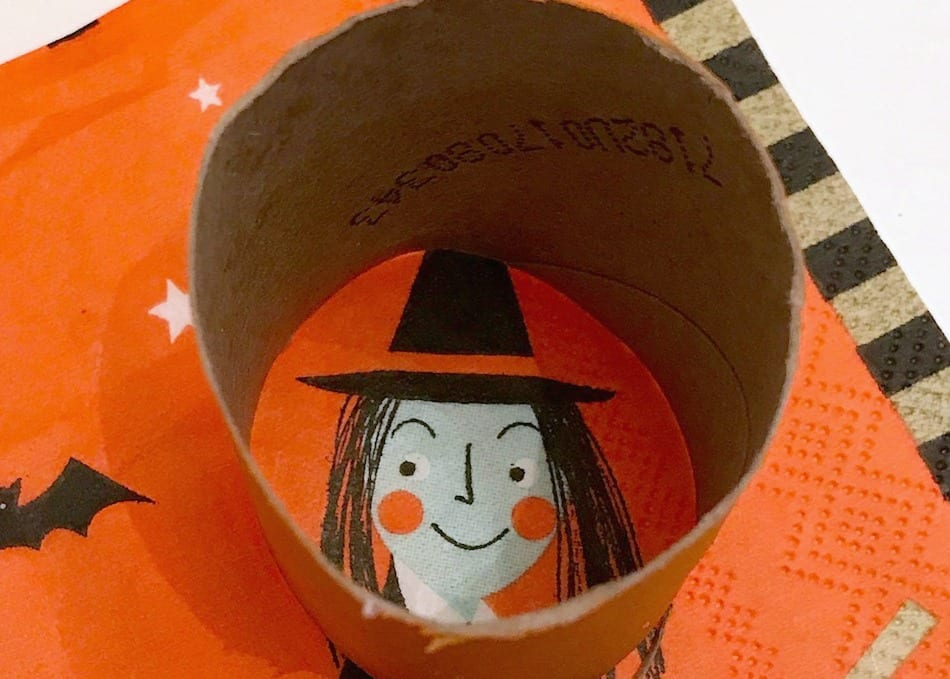 Halloween witch napkin lined up inside a toilet paper roll