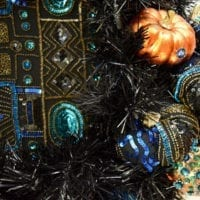 Black wreath made with sequined jacket and pumpkins