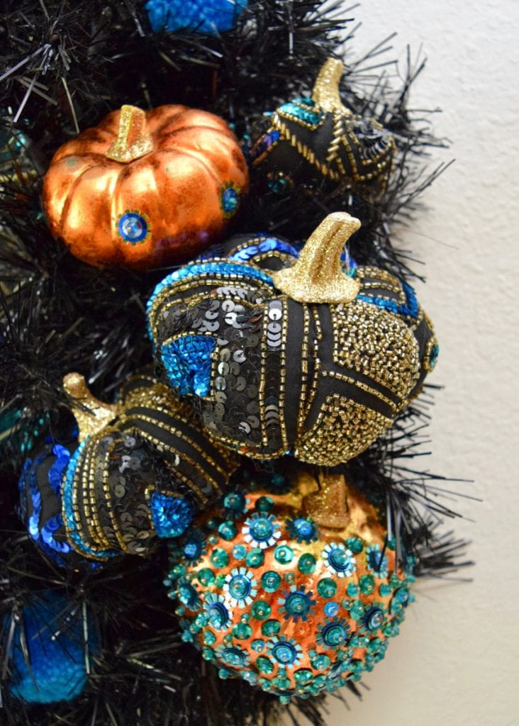 DIY sequin pumpkins on a black Halloween wreath