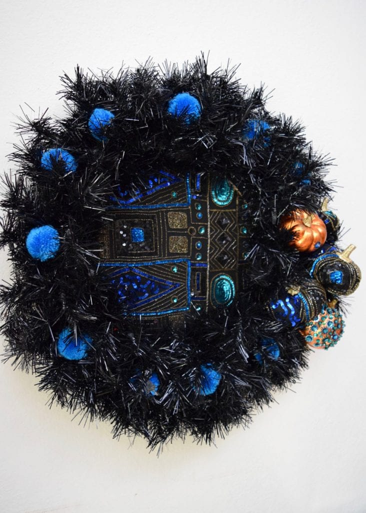 Black Halloween wreath with DIY pumpkins made from a sequined jacket