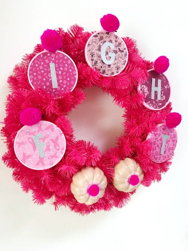 Pink wreath for breast cancer awareness that says fight