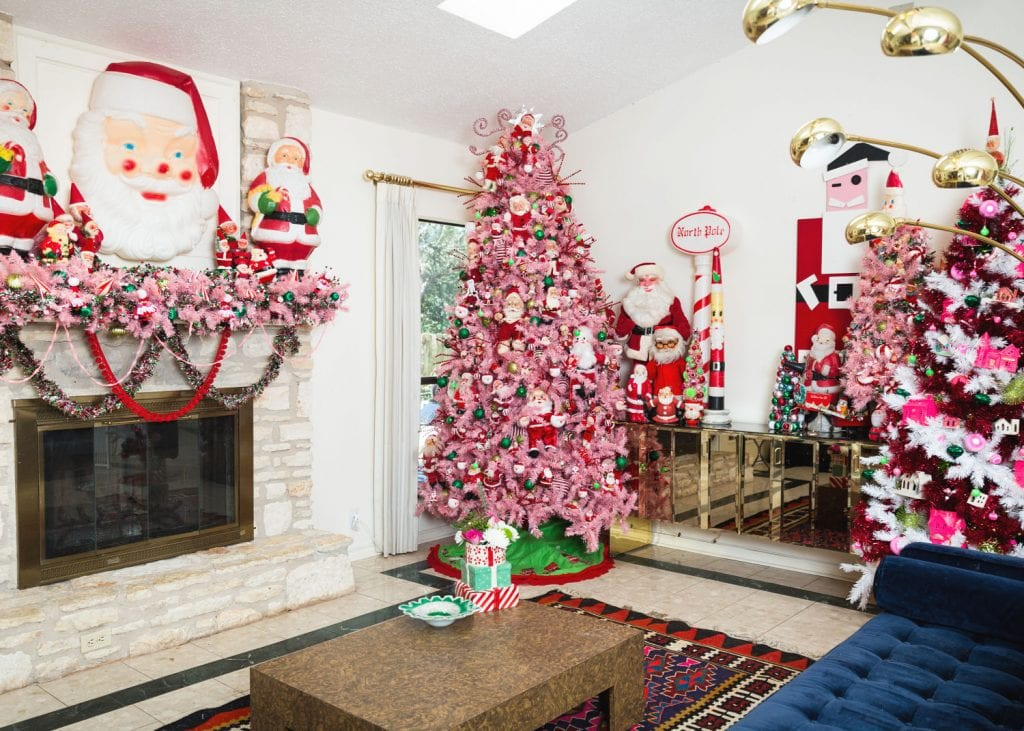 Collection of vintage Santa dolls and large pink Christmas tree
