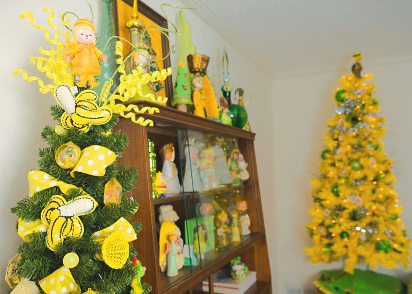 Two Christmas trees with a mod theme in yellow and green.