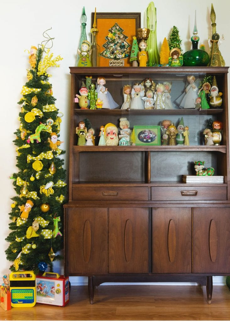 Vintage wooden cabinet and green pencil tree decorated for Christmas