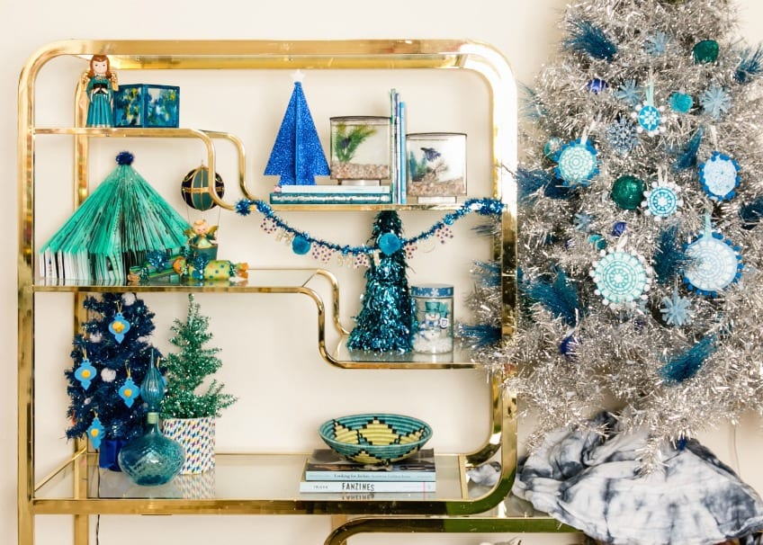 Etagere full of teal Christmas decorations