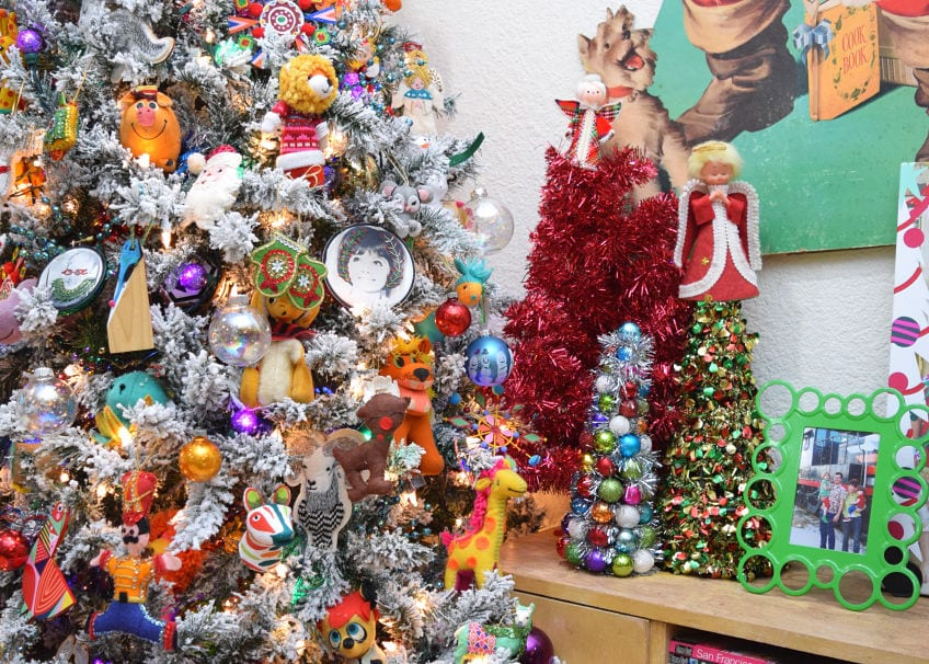 Flocked Christmas tree with colorful kitschy ornaments