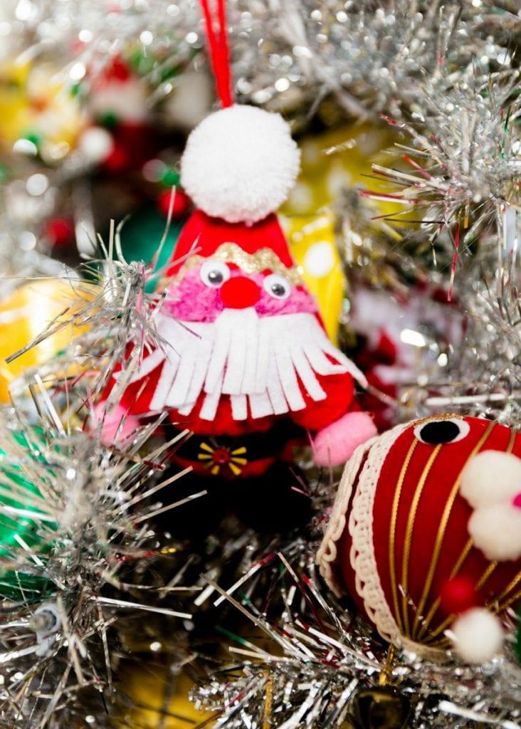 Adorable DIY Kitschmas ornament of a pompom Santa