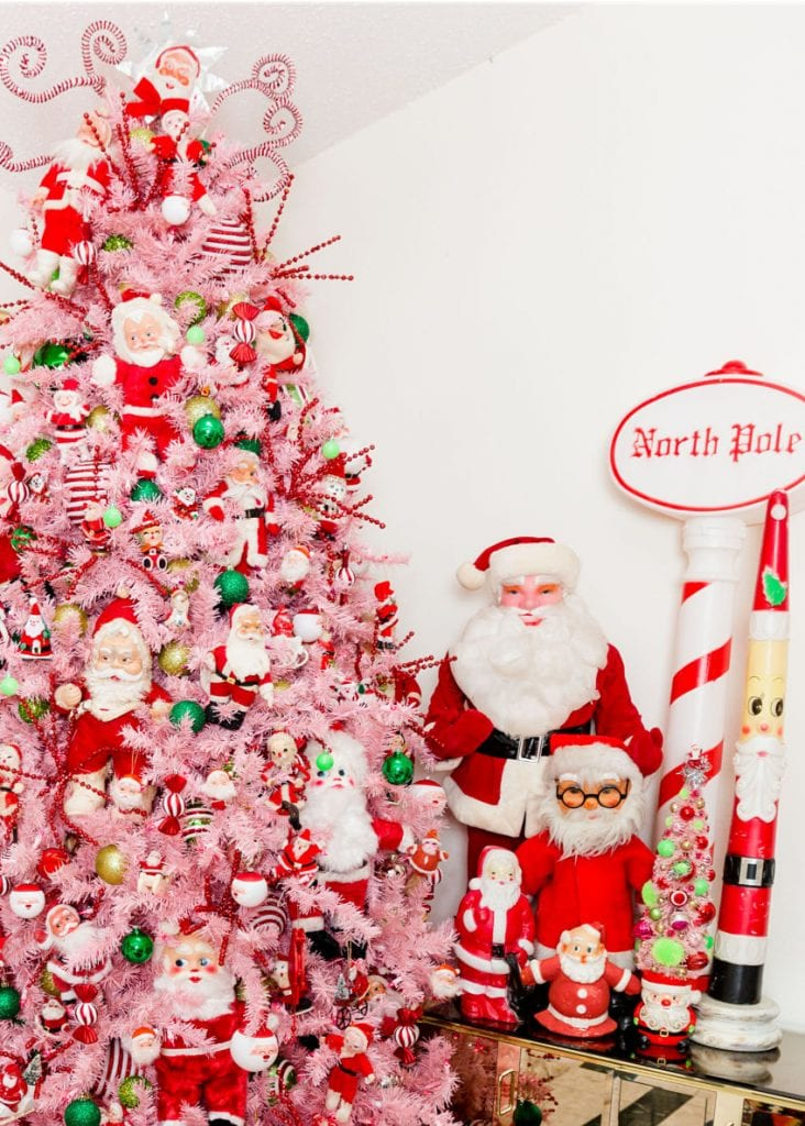 9ft pink Christmas tree with vintage Santa doll decorations