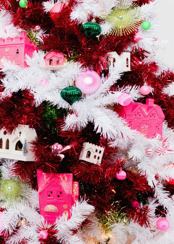 Candy cane striped tree decorated with pink Putz houses