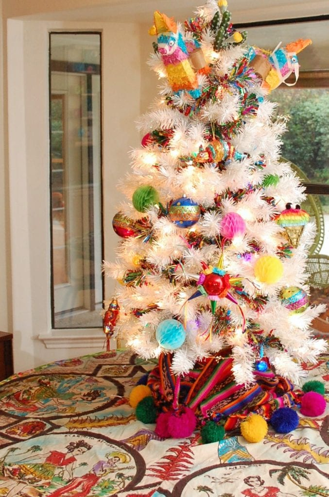 Feliz Navidad themed Christmas tree with a vintage souvenir skirt as a tree skirt