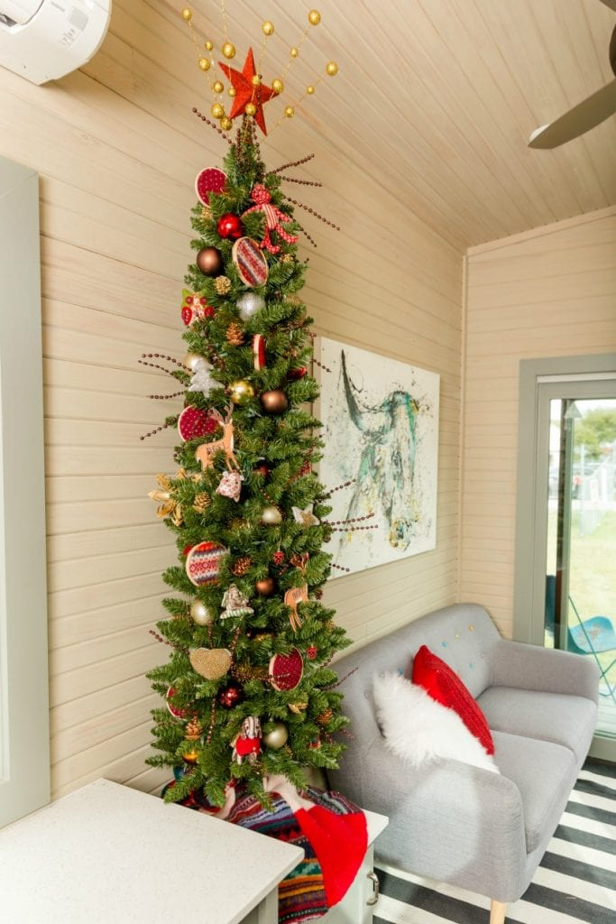 Slim Christmas tree in a tiny house