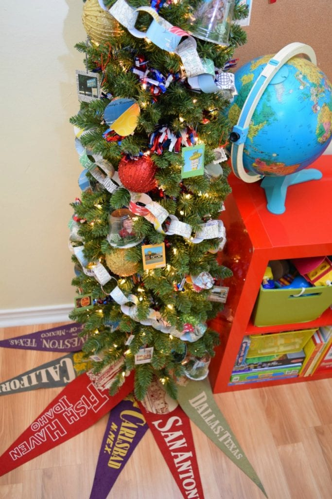 Collection of vintage travel pennants as a Christmas tree skirt