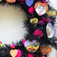 Black wreath with hand painted hearts by Jennifer Perkins Art
