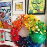 Gallery wall with a rainbow wreath covered in lucky coins