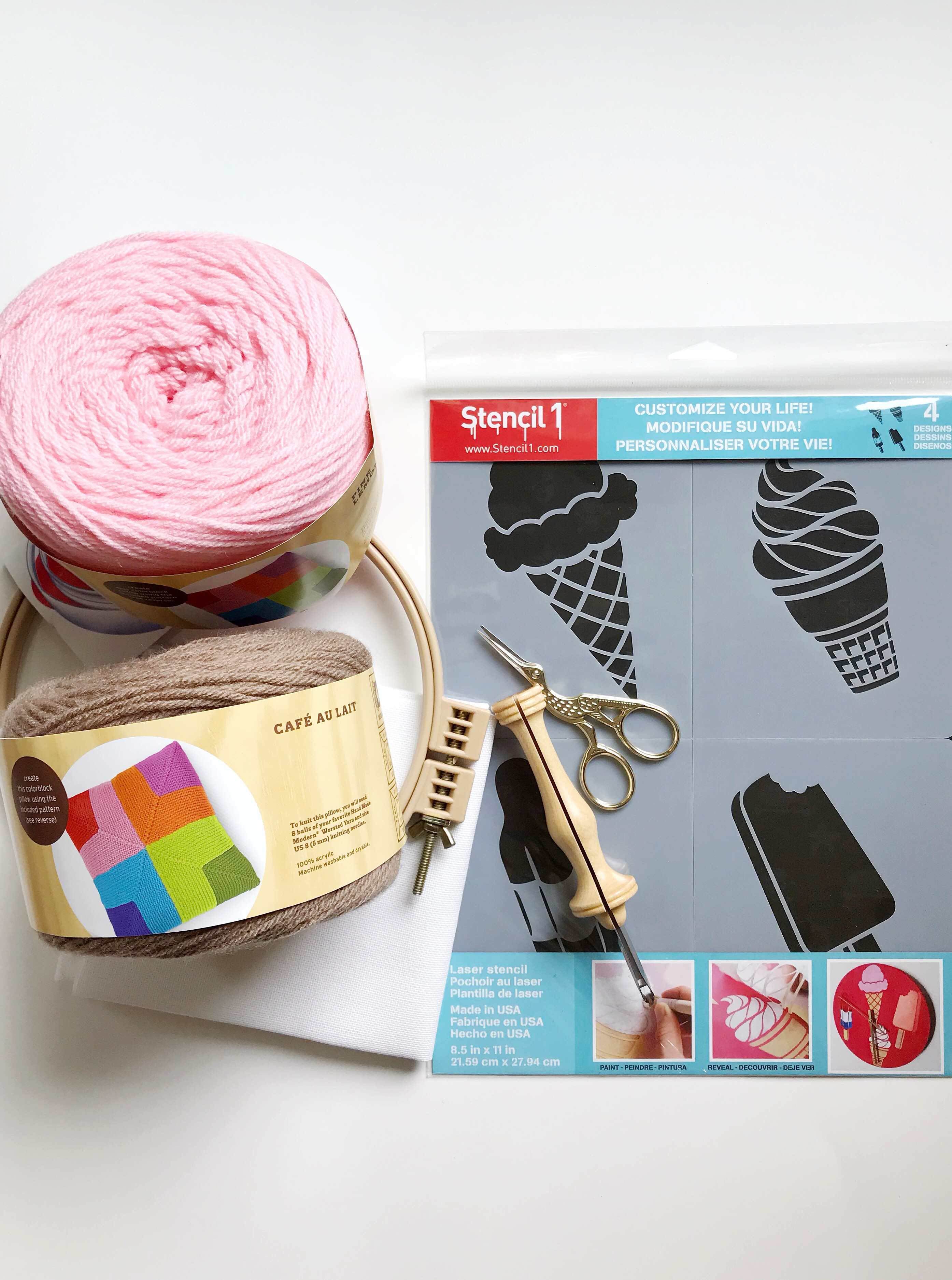 Supplies for making a DIY punch needle patch with an ice cream stencil