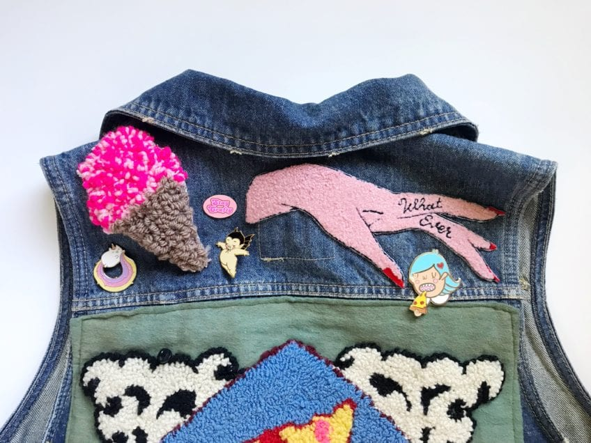 Denim jacket with pins and DIY patches