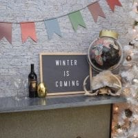 Game of Thrones letter board with Winter is Coming written on it.