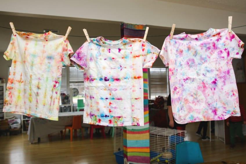 Hanging DIY ice dyed T-shirts