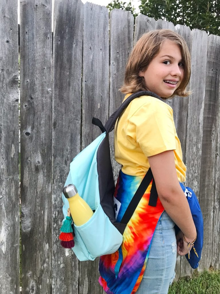 Girl headed to school with backpack