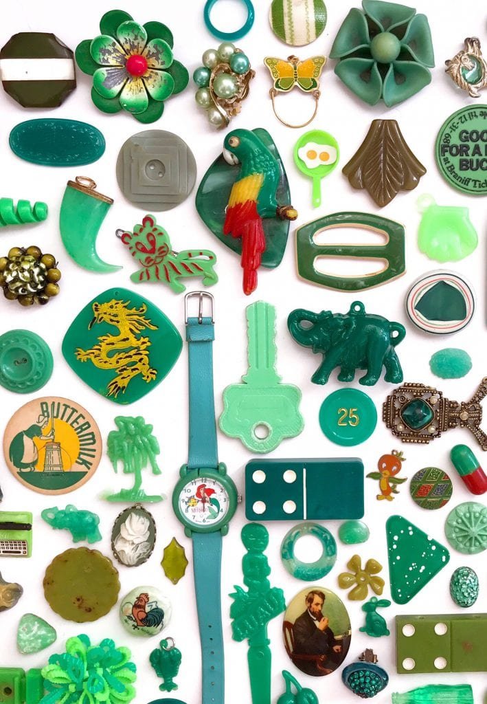 Flat lay of vintage trinkets in green by Jennifer Perkins