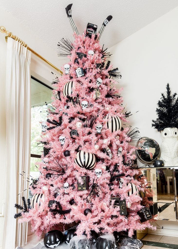 Large pink Christmas tree decorated for Halloween in black and white by Jennifer Perkins