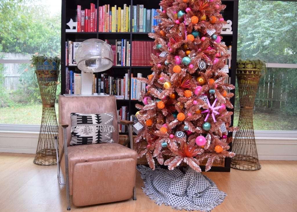 Jennifer Perkins styles a rose gold christmas tree with a vintage beauty parlor chair.