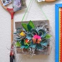 Hanging display of felt succulents