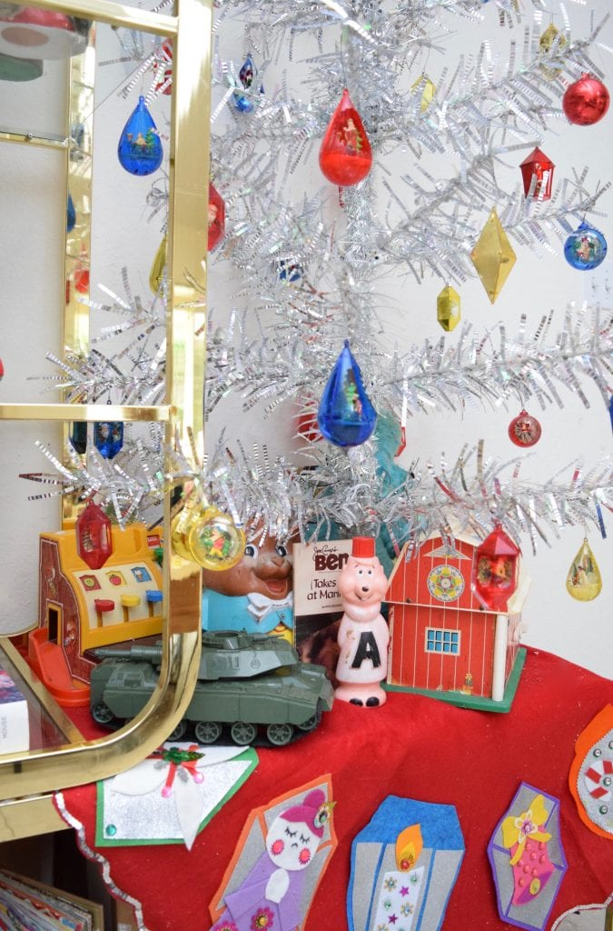 Vintage toys under a silver tinsel Christmas tree