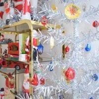 Silver tinsel Christmas tree with Jewel Brite ornaments.