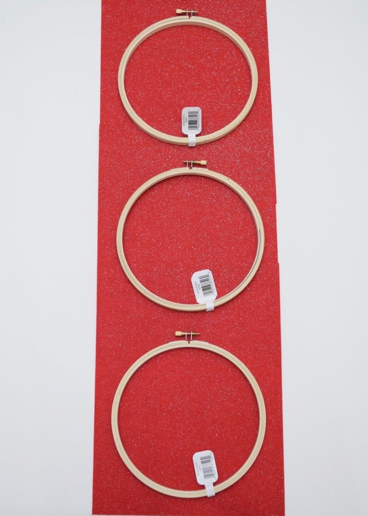 Laying out embroidery hoop pockets for Christmas card holder project.