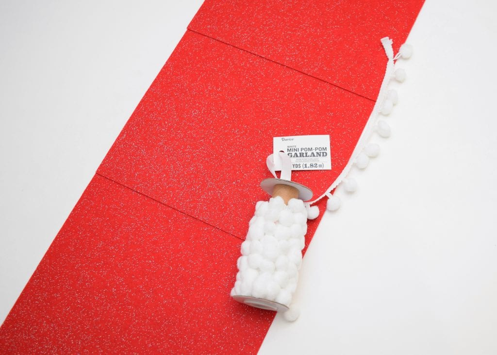 Laying out felt for the background of a vintage inspired wall hanging Christmas card holder.