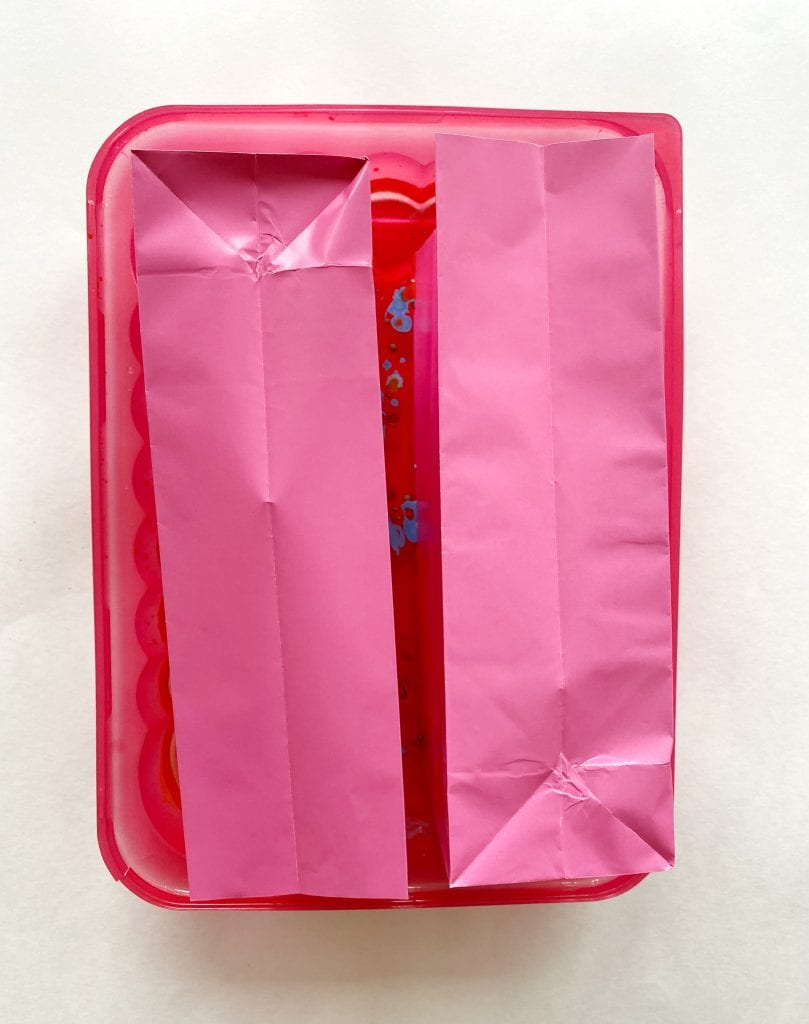 Pink paper party bags in marbling medium