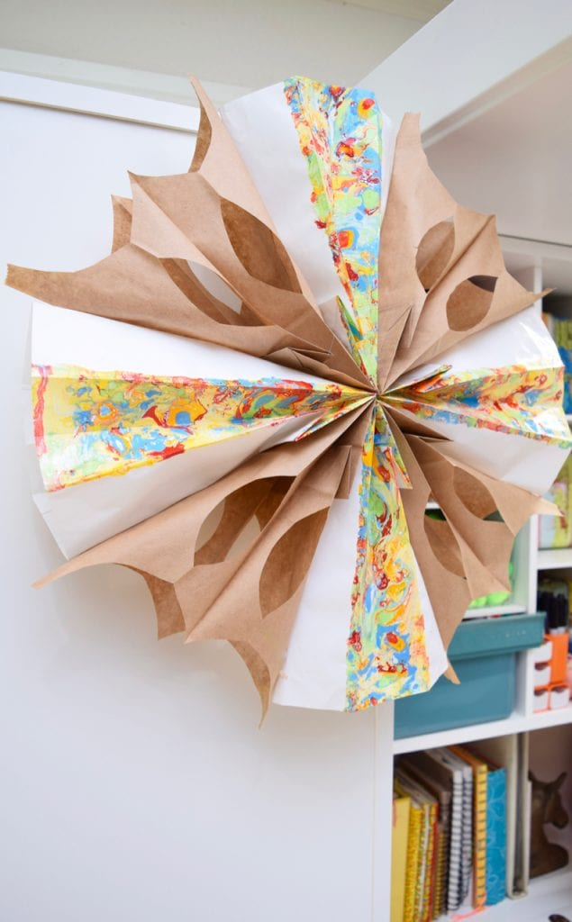 Lunch sacks and marbled paper bags make a DIY party decoration.