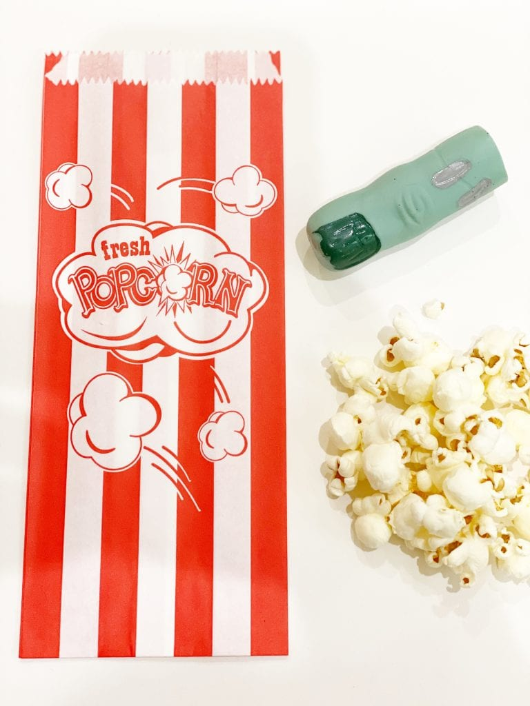 Supplies to make zombie popcorn bags